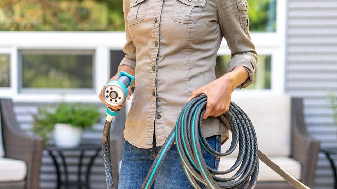 woman holding garden hose