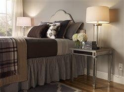 twin sized bed with 2 lights on double night stand