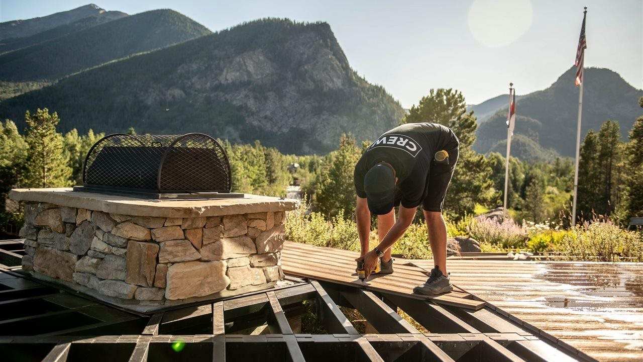crew person installing fire pit