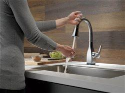 Woman washing hands at Delta Mateo sink with Touch2O Technology