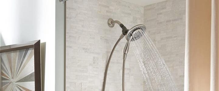 shower head spraying water in an unscale bath