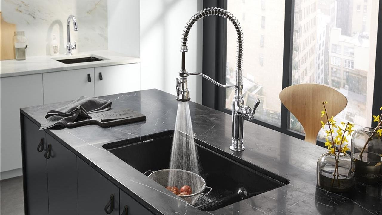 beautiful faucet in quarts sink in upscale kitchen