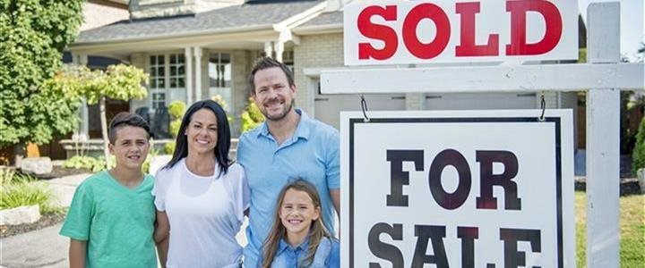 family next to sold sign in front of there house