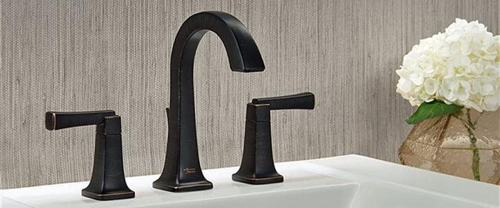 close up of oiled bronze finished faucet in bath sink