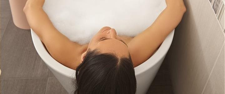 woman relaxing in a warm bubble bath