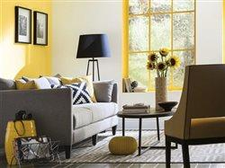 lovely living room with yellow accent wall and grey and navy accent pieces