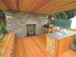Outdoor kitchen made of rock and cedar