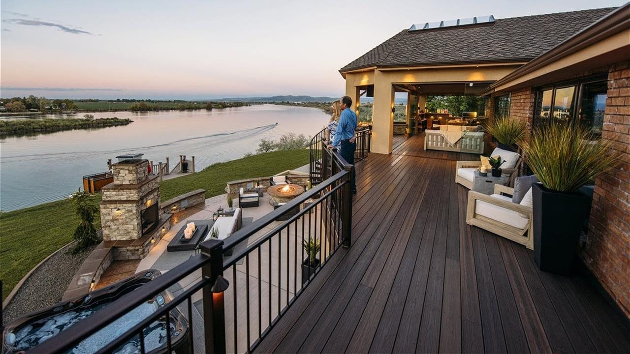 Luxury home with beautiful deck overlooking body of water