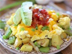 potatoes eggs cheese salsa and avocado breakfast