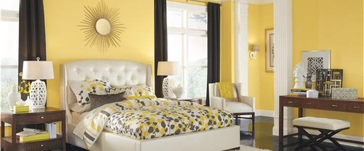 Beautiful bright yellow bedroom in upscale home