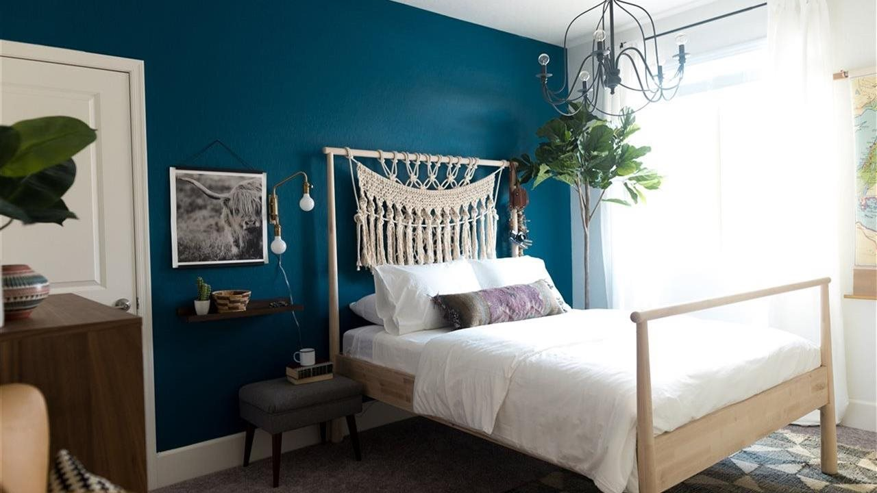 bedroom with oceanside accent wall