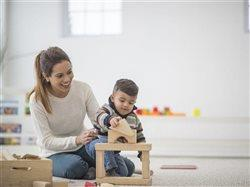 mother playing with little boy and blocks