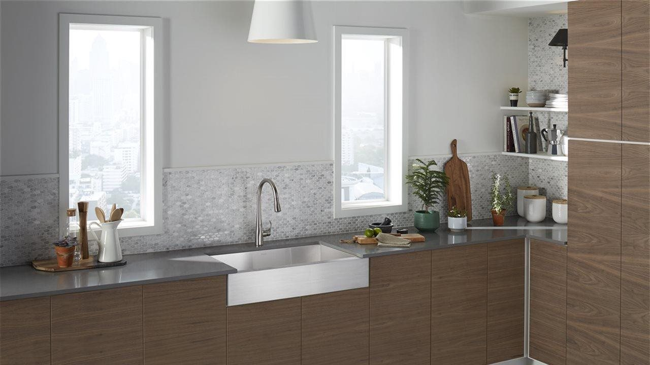 Modern kitchen with upscale faucet, sink and subway tile