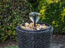Fountain water feature with river rock and a pot