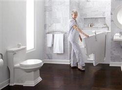 Middle-aged woman opening door to bath tub