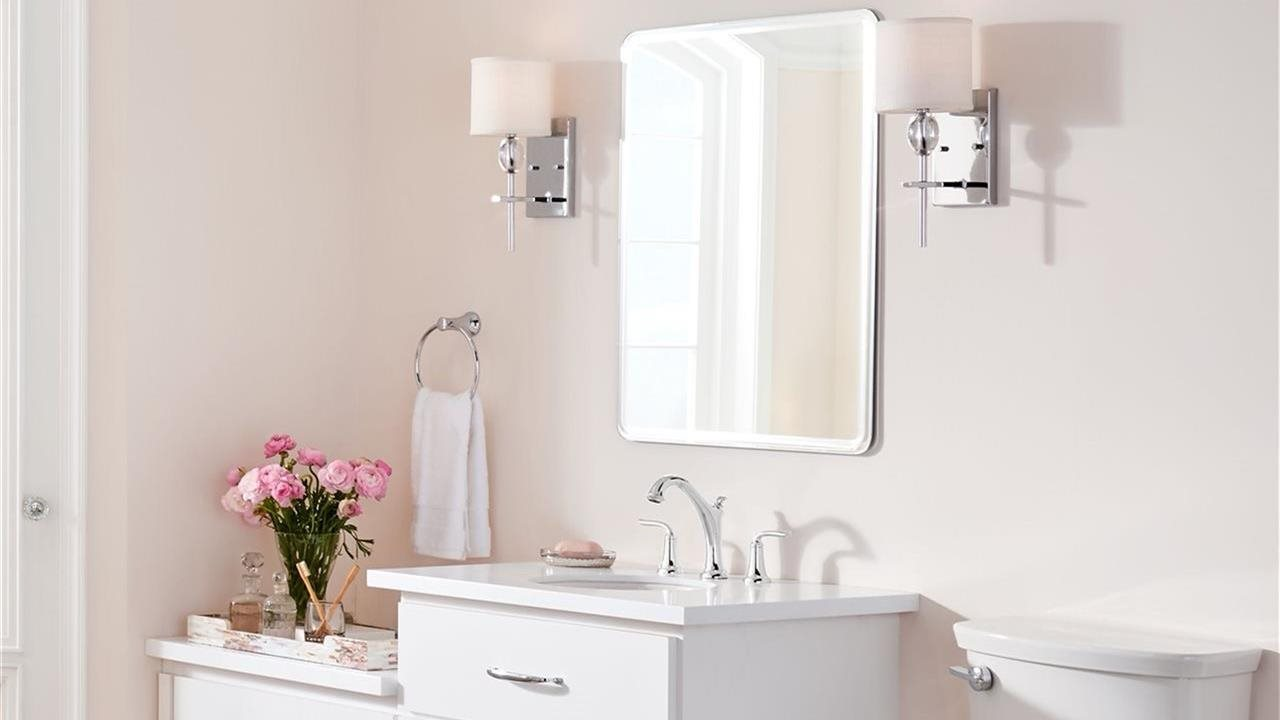 vanity faucets, mirror and lights in powder room