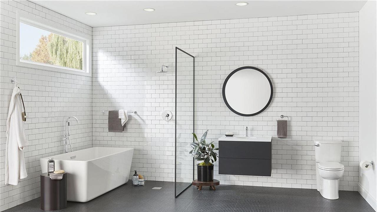 Black and white bath with tile, bath tub, toliet and upscale faucets