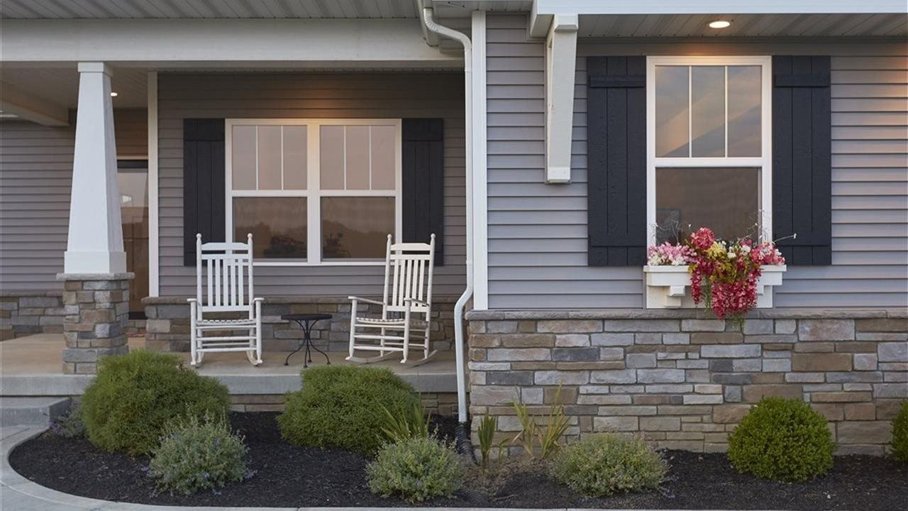 front porch on a house with chairs
