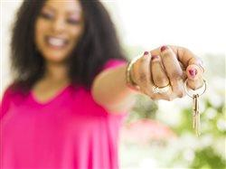 new homeowners holding a set of house keys