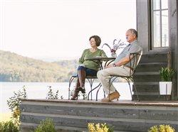 boomer couple sitting on porch