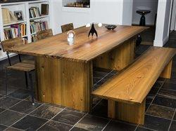 Milled from long-submerged cypress logs, RE-CO BKLYN used live-edge slabs of sinker cypress, to make a handsome dining table and matching bench.