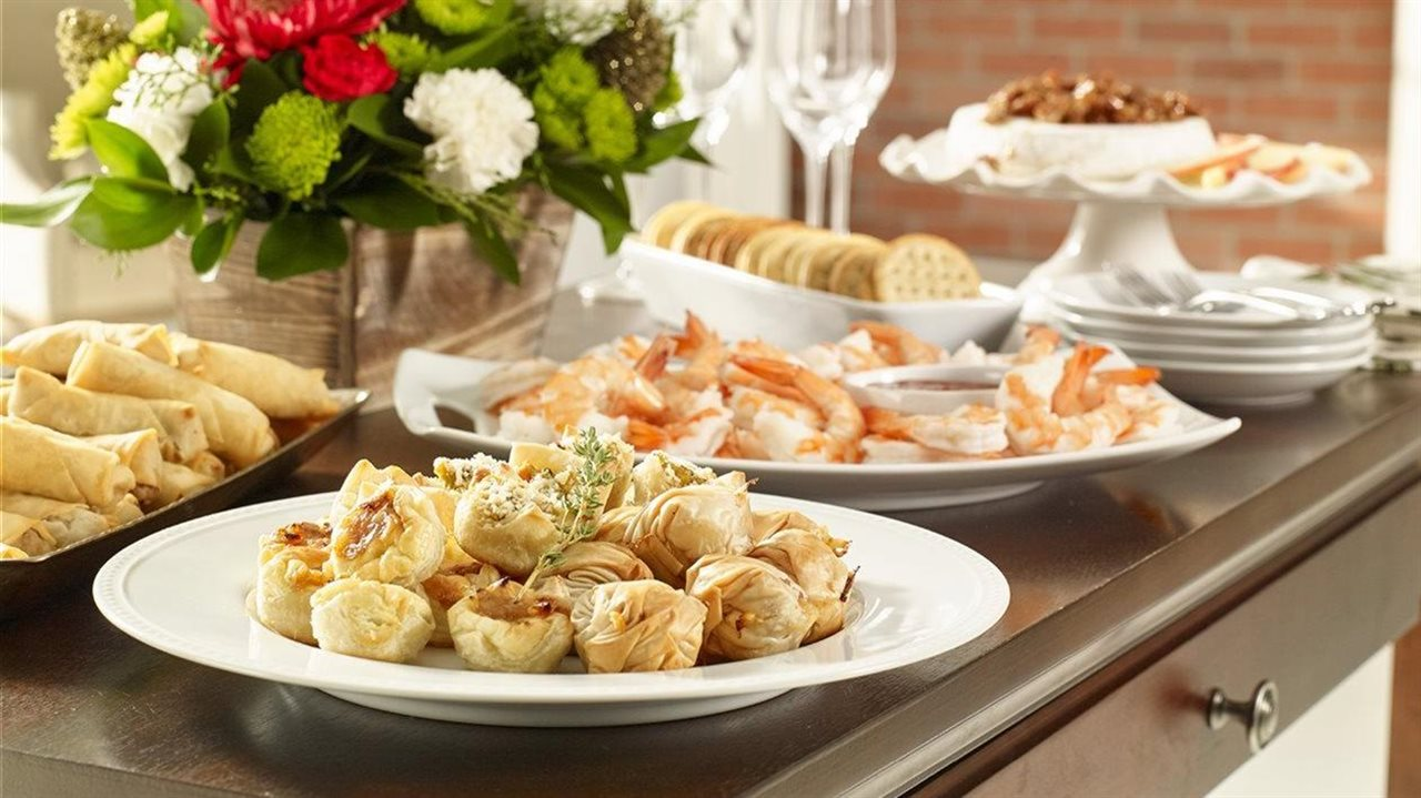 Holiday Appetizer spread with floral arrangement.