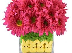 peeps in the bottom of a vase with jellybeans and flowers