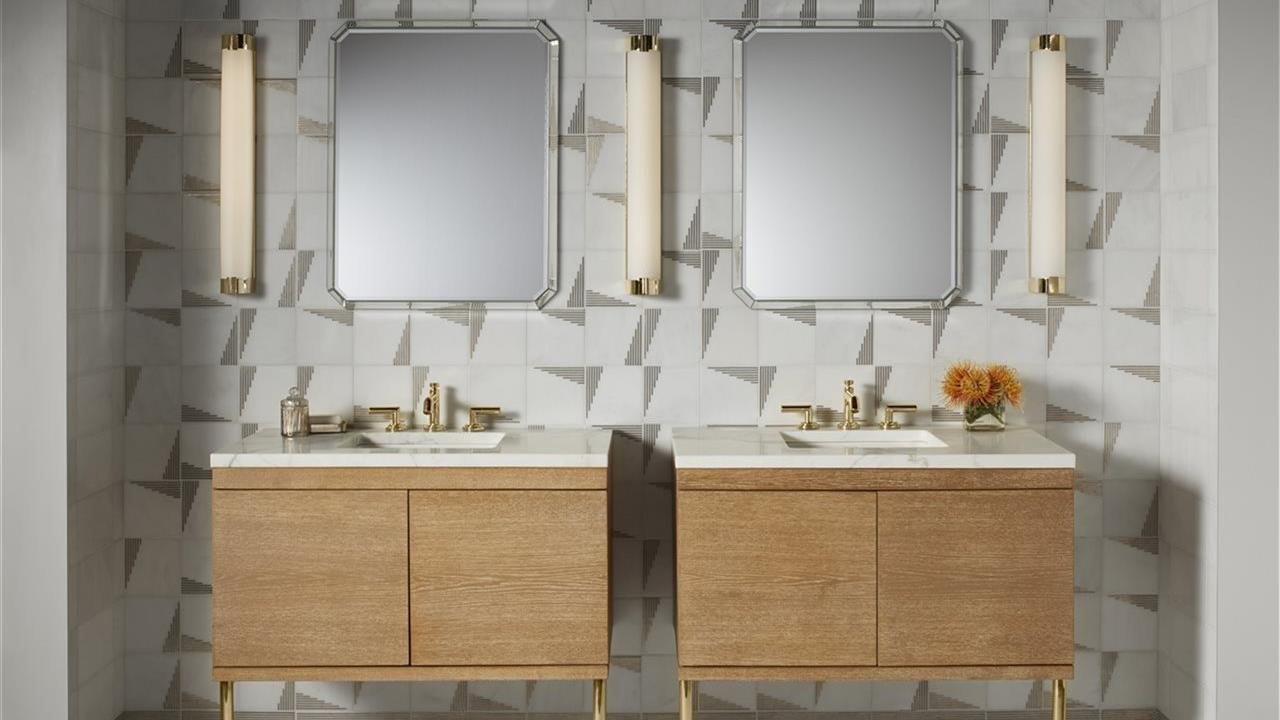 double sinks with mirrors and lights in bath