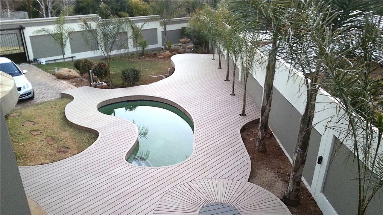 birds eye view of a pool and deck