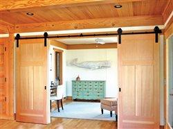 sliding doors in a house leading to sitting room