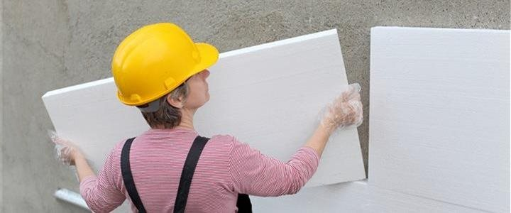 woman sizing ridge insulation for a building