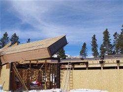 Insulation being put into place on a structure