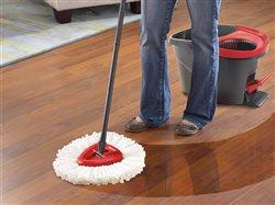 close-up of woman mopping hardwood