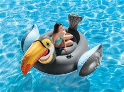 woman relaxing in an inflatable toucan in a swimming pool