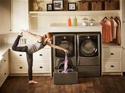 woman doing yoga and laundry