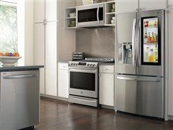 lg kitchen featuring refridgerator, dishwasher, oven and microwave