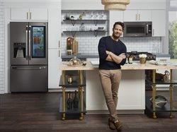 Man standing in front of a kitchen island.
