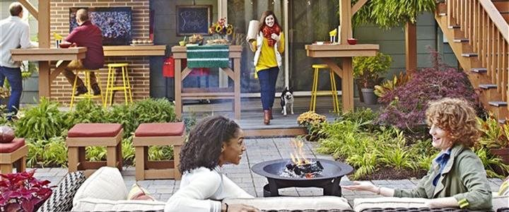 friends enjoying outdoor living room in backyard