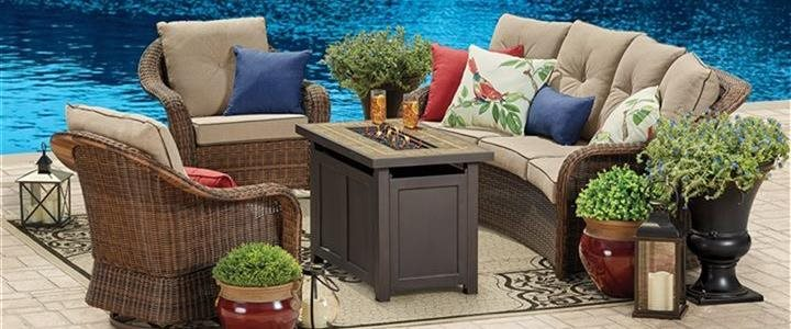 outdoor furniture on patio near water