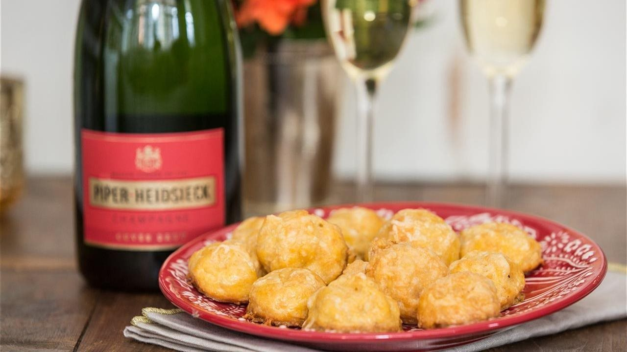Champagne in fluted glasses with gougeres