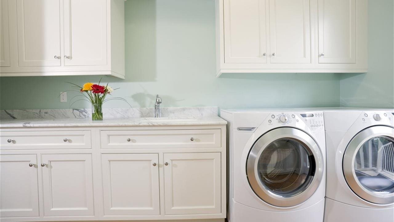 Laundry room with tons of cabinets