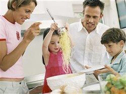 family having fun making meal together in the kitchen