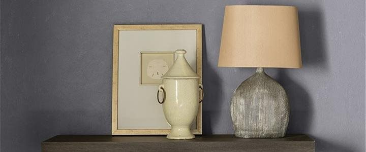 beautiful rich muted color wall behind lamp table