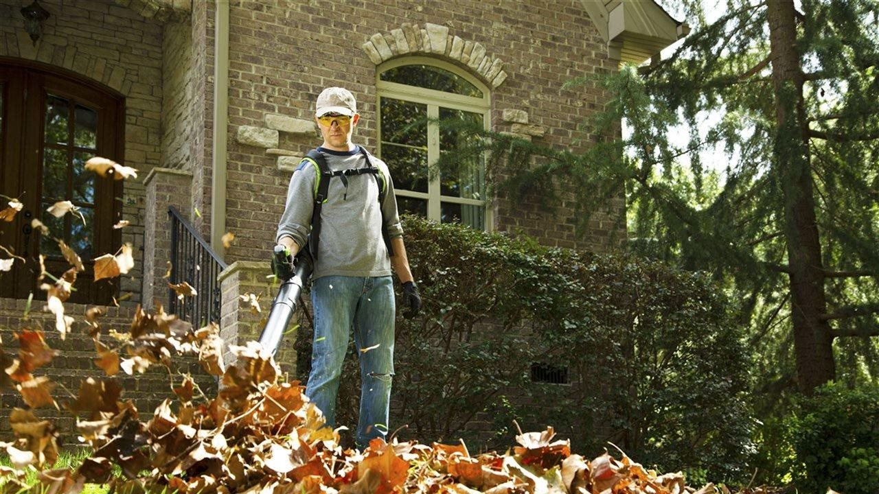 man using  a leaf blower