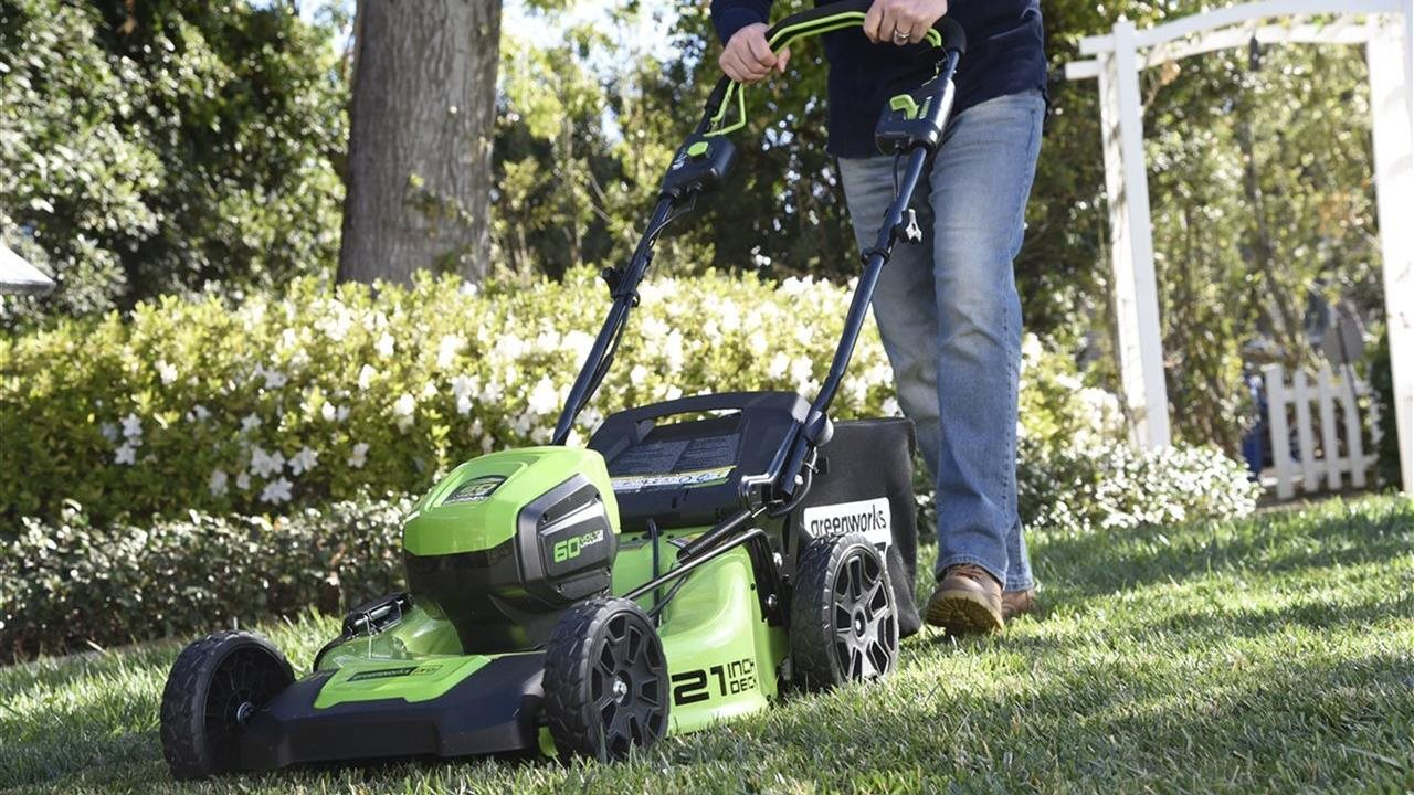 person mowing their lawn with a lawn mower