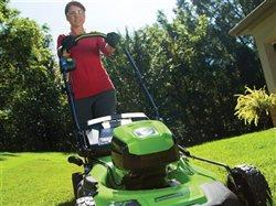 woman mowing the lawn with mower