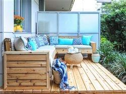 Beautiful wooden deck with outdoor furniture and pillows