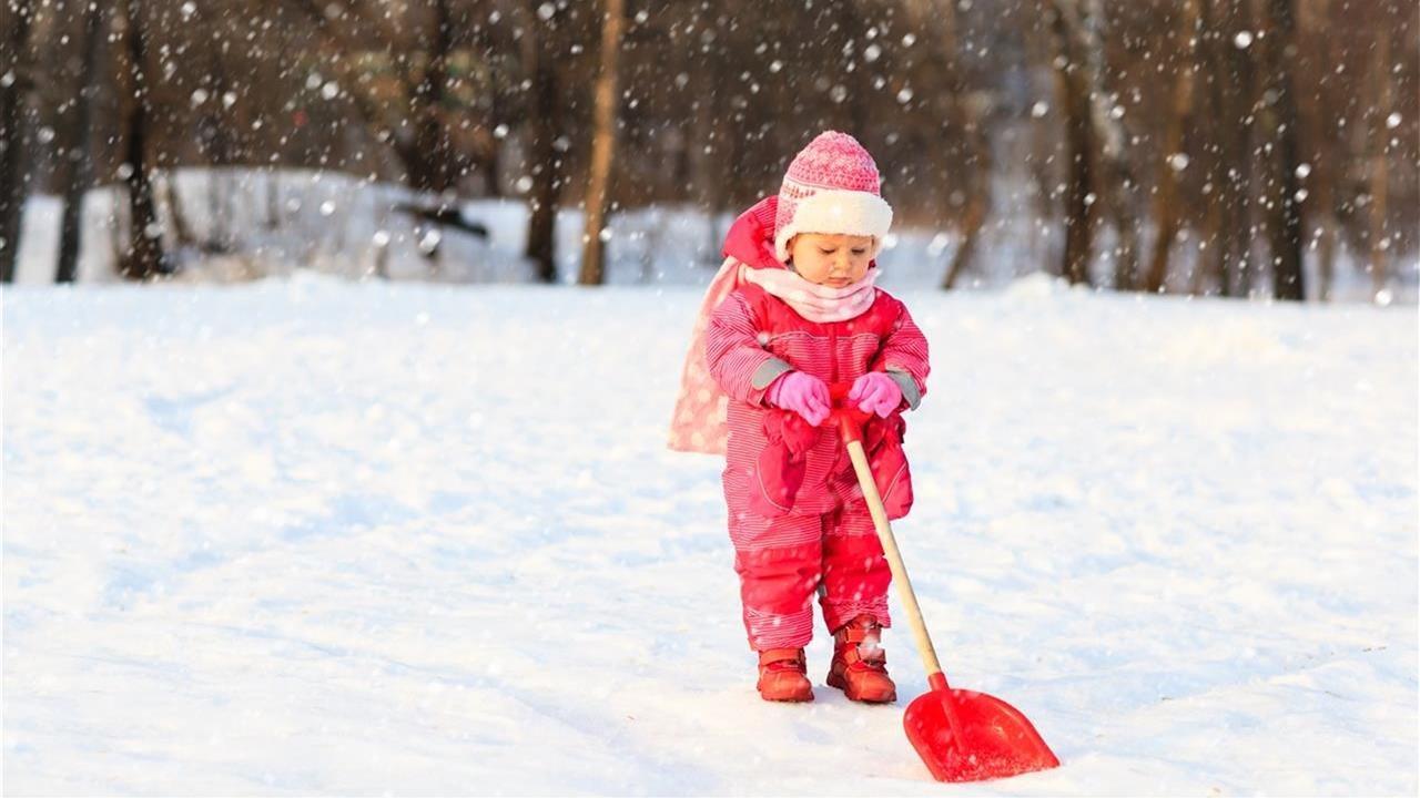 cute little girl shoveling snnow