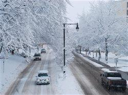 vehicles on a snow covered city street