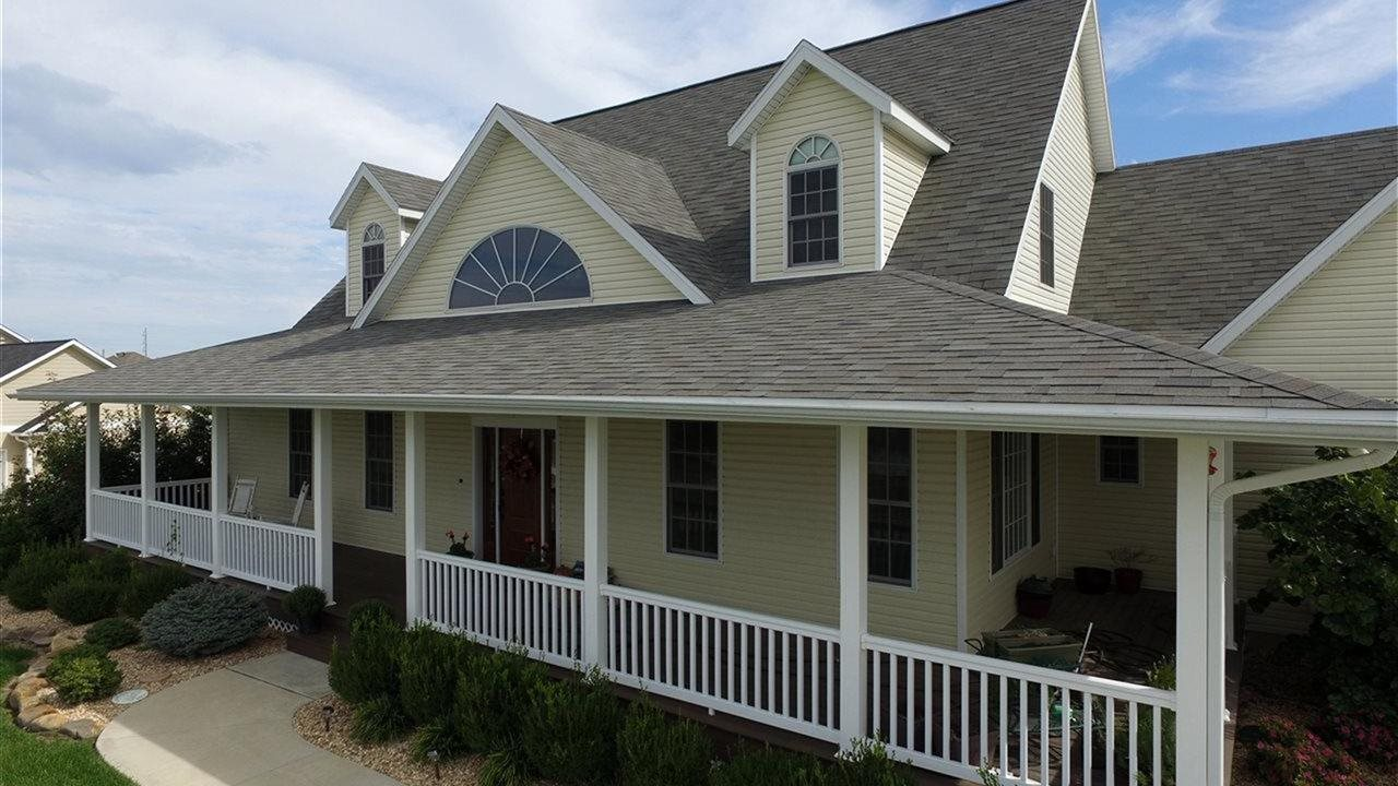 house with wrap arround porch